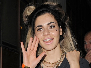 "Marina Diamandis aka Marina and the Diamonds, arrives at the BBC Radio 1 studios for a brief interview, leaving 30 minutes later. Marina was not dressed for the cold, wet weather, despite complaining on her twitter account that it was like ""December outside"". London"