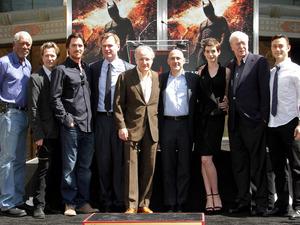 Morgan Freeman, Gary Oldman, Christian Bale, Christopher Nolan, Michael Mann, Anne Hathaway, Sir Michael Caine and Joseph Gordon-Levitt gather for the photographers.