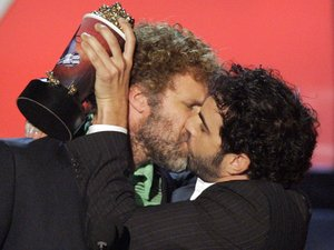 "Will Ferrell, left, and Sacha Baron Cohen share a moment after accepting the award for best kiss in ""Talladega Nights: The Ballad of Ricky Bobby"" during the 2007 MTV Movie Awards, 2007"