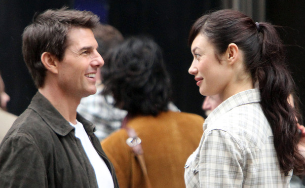 Tom Cruise and Olga Kurylenko filming on the set of 'Oblivion' at the foot of the Empire State Building New York, City
