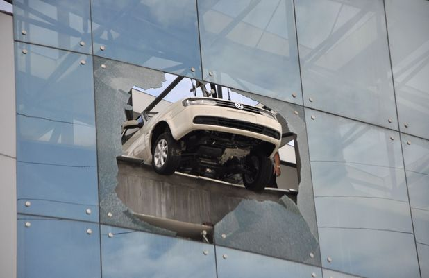 Customer accidentally drives car through window at car sales shop in Liuzhou, Guangxi Province, China