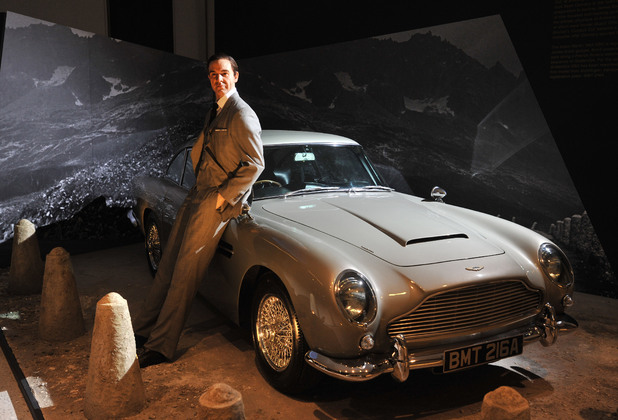 1964 Aston Martin DB5 with a Sean Connery wax figure Designing 007 - Fifty Years of Bond Style - press view held at the Barbican Centre. London, England