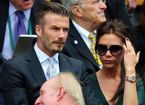 David and Victoria Beckham in the Royal Box during day thirteen of the 2012 Wimbledon Championships.