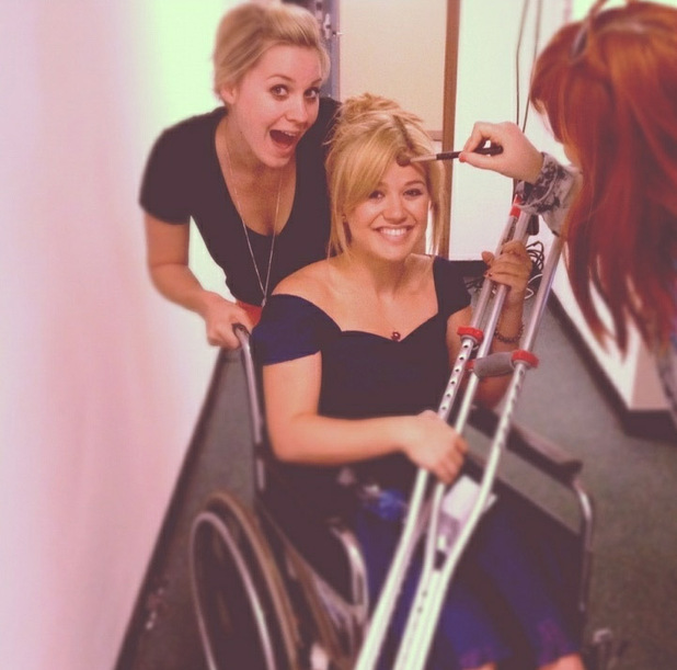 Kelly Clarkson in a wheelchair following a foot injury