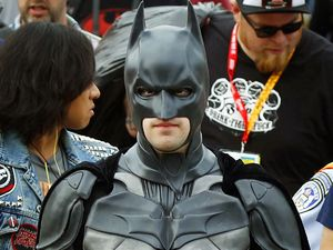 Fan dressed as Batman within the Comic-Con crowds
