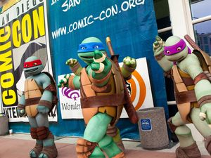 Fans dressed as Teenage Mutant Ninja Turtles