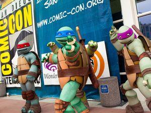 Fans dressed as Teenage Mutant Ninja Turtles