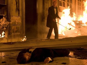 Bruce Wayne / Batman portrayed by Christian Bale in an attack on his Gotham Mansion, with Butler Michael Caine in 'Batman Begins'