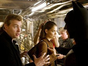 Christopher Nolan directing Batman Begins with Christian Bale (Batman/Bruce Wayne) and Katie Holmes (Rachel Dawes)
