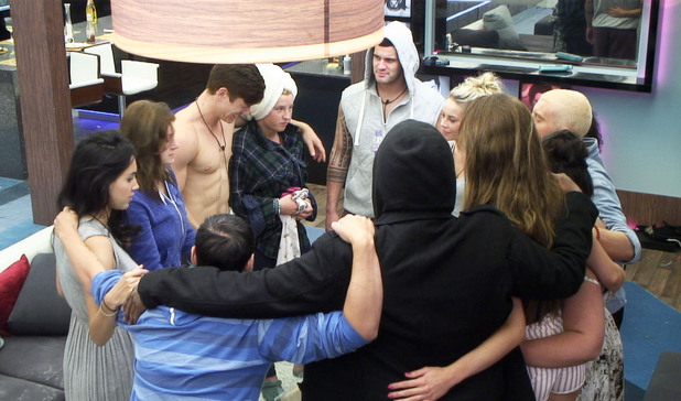 The housemates share a group hug