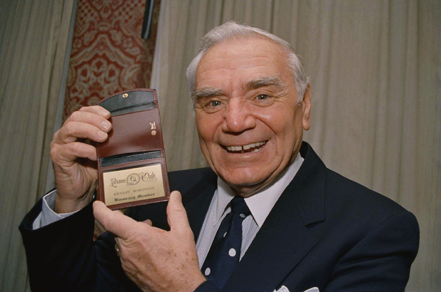 Ernest Borgnine holds up his Friars Club membership card