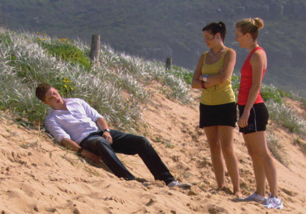 Sasha and Natalie find a hung over Casey sleeping on the beach.