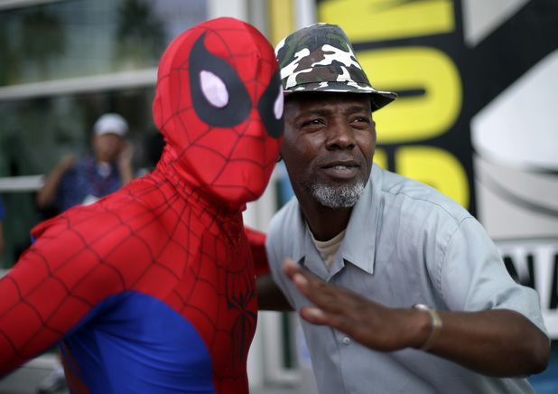 Ray Senore poses with a man dressed as Spiderman
