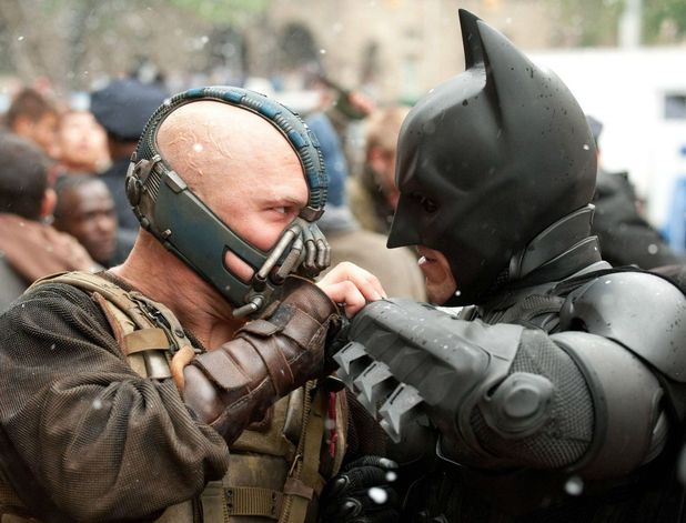 Batman (Christian Bale) in battle with Bane (Tom Hardy) in the The Dark Knight Rises