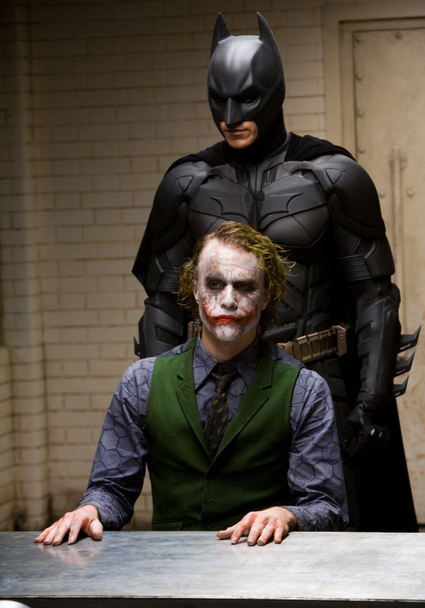 Christian Bale as Batman/Bruce Wayne and Heath Ledger as The Joker in The Dark Knight