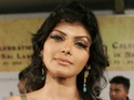 "Sherlyn Chopra describes Hugh Hefner's company as a ""true pleasure""."
