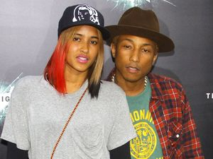 Pharrell Williams, Helen Ladichanh at 'The Dark Knight Rises' world premiere, July 2012