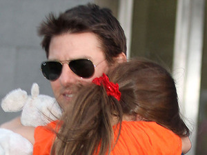 Tom Cruise and his daughter Suri leave Chelsea Piers after spending the day together for the first time since Tom Cruise split with Katie Holmes