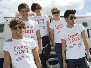 One Direction ready to board their flight.