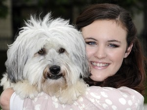 "Ashleigh and Pudsey unveil the new PETA advertisement opposite the Houses of Parliment, Westminster, London.'Britain's Got Talent' winners stick up for Lions, Tigers and other Wild Animals -  Who are forced to perform and made to sufferThey recently took the UK airwaves by storm, and now they hope to cast a little gloom towards the cruel circus industry. Britain's Got Talent winners Ashleigh and Pudsey  the crowd-pleasing dance team of 17-year-old Ashleigh Butler and her canine sidekick, Pudsey  appear in a hard-hitting new anti-circus ad. The bleak ad shows a very different side to the usually bubbly duo, as Ashleigh portrays a sombre clown while Pudsey sits next to her dressed as a battered lion. The caption reads, ""The Saddest Show on Earth  Get Wild Animals Out of the Circus!""London, England - 21.06.12 Mandatory Credit: WENN.com"