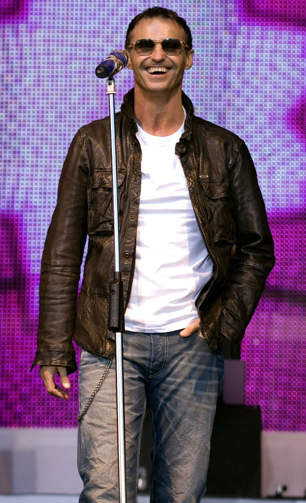 Marti Pellow of Wet Wet Wet performs live on stage at Glasgow Green to celebrate the 25th anniversary of their first appearance at the same venue.
