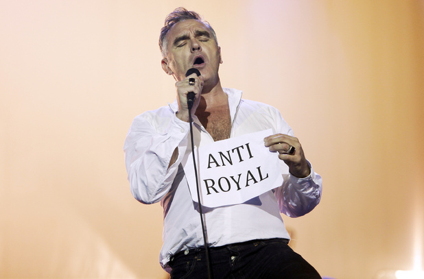 Morrissey holds an 'Anti Royal' sign as he performs live in concert in an open-air theater in Istanbul, Turkey