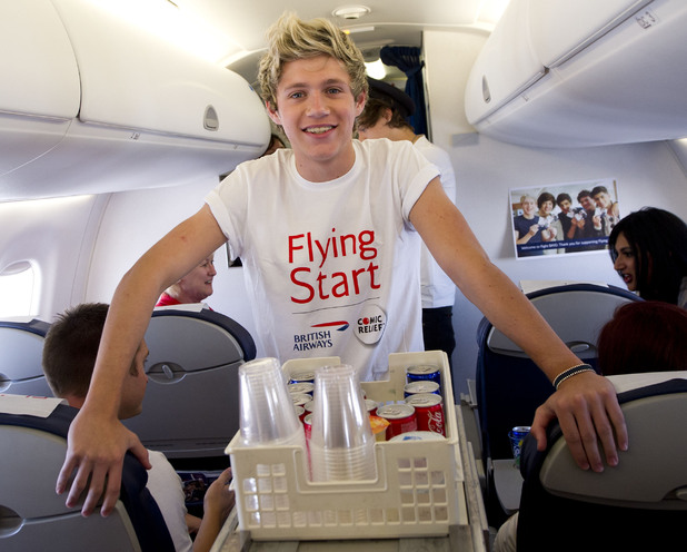 Niall Horan serves drinks on board the flight.