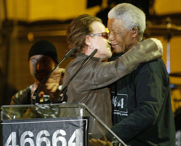 Nelson Mandela is hugged by U2 lead singer Bono at the 46664 benefit  concert in 2003