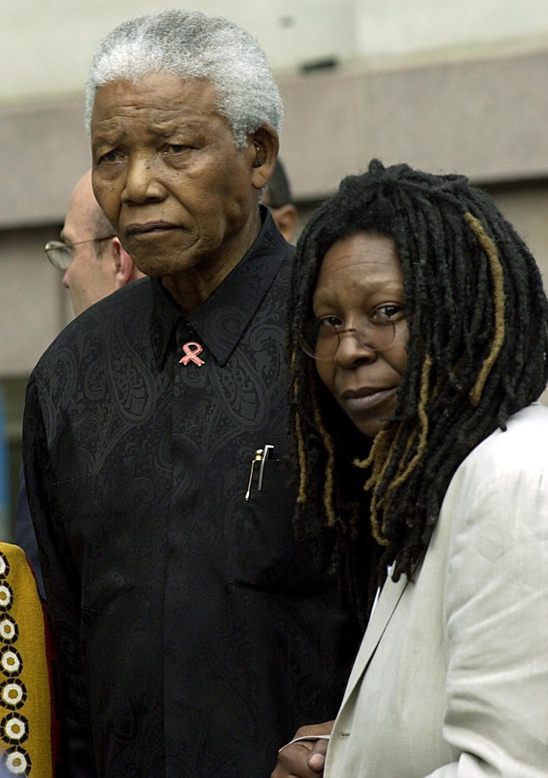 Nelson Mandela stands with Whoopi Goldberg