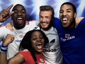Beckham looks a little overwhelmed by these ecstatic fans