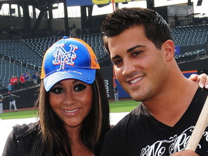 A pregnant Nicole 'Snooki' Polizzi and her fiance Jionni LaValle pose with baseball bats after meeting the New York Mets baseman David Wright at Citi Field, New York