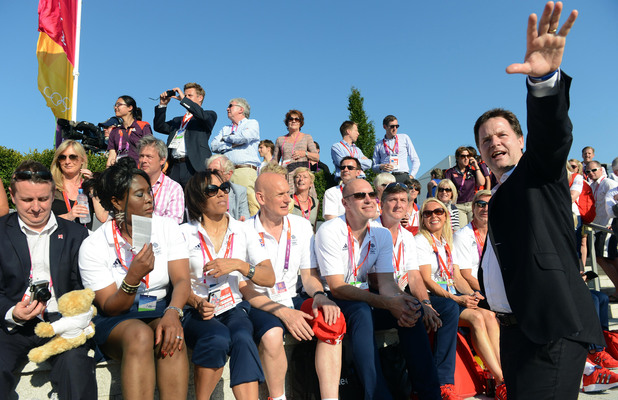 Deputy Prime Minister Nick Clegg (right) with former Olympic athletes during the Welcome Ceremony at the Athletes Village, Olympic Park, London.