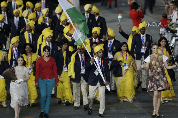India's Sushil Kumar carries the flag during the Opening Ceremony at the 2012 Summer Olympics and is invaded by a gatecrasher.