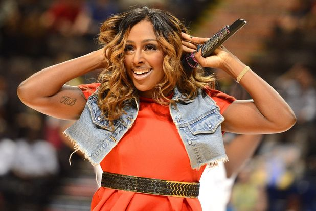 British singer Alexandra Burke performs at halftime during the Olympic women's exhibition basketball game between Team GB and USA at the M.E.N Arena in Manchester