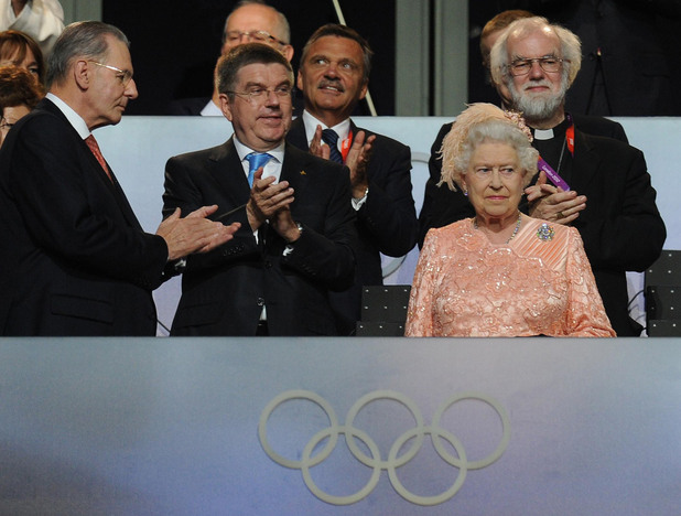 The Queen and IOC President Jacques Rogge arrive during the London Olympic Games 2012 Opening Ceremony.