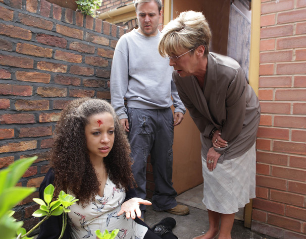 In a fit of anger, Kirsty tries to grab Tyrone. He shoves her away, causing her to stumble and fall