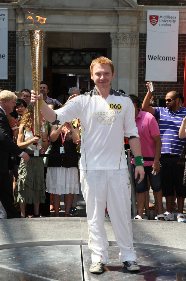 Rupert Grint carrying Olympic Torch