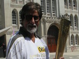 Amitabh Bachchan carrying Olympic torch