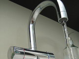image of a tap and water