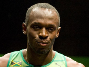Usain Bolt, Jamaican sprinter Usain Bolt wearing the 2012 Jamaican Olympic kit during a photocall at Village Underground, London.