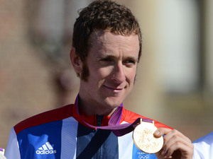 Great Britain's Bradley Wiggins (centre) poses with his gold medal after winning the Men's Individual Time Trial, with second placed Germany's Tony Martin and third placed Great Britain's Chris Froome (right) on day five of the London Olympic Games at Hampton Court Palace (August 1st)