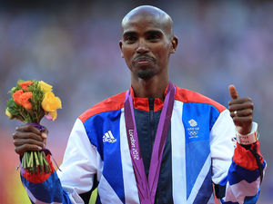 Mo Farah receives his gold medal.