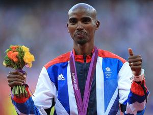 Mo Farah receives his gold medal.