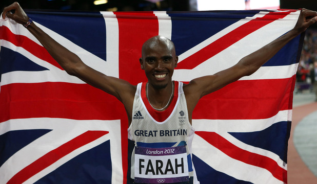 Mo Farah does a victory parade after winning the Men's 10,000m Final.