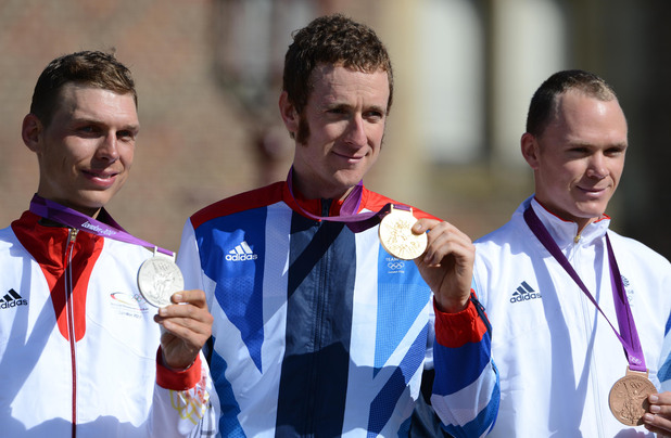 Bradley Wiggins (centre) poses with his gold medal