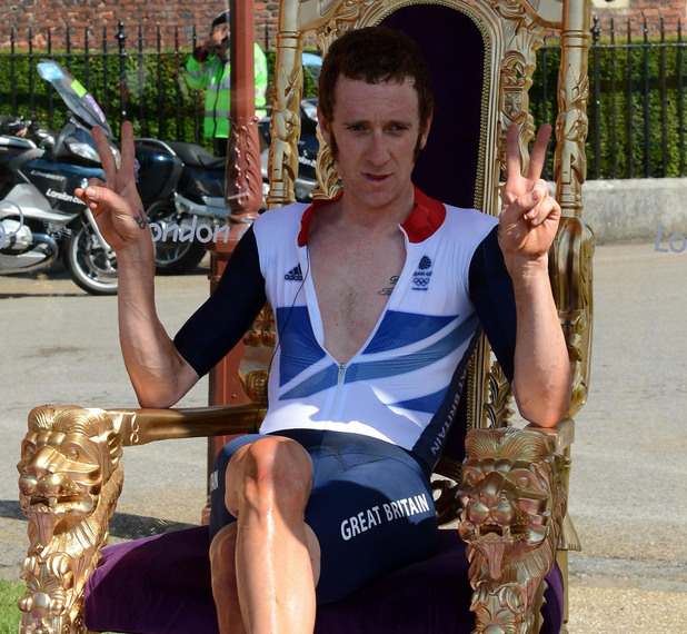 Great Britain's Bradley Wiggins sits on the throne as he celebrates winning the Men's Individual Time Trial on day five of the London Olympic Games at Hampton Court Palace
