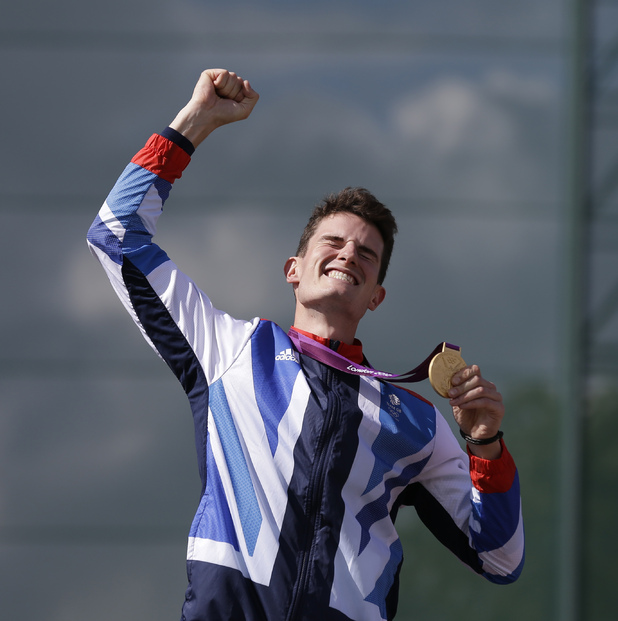 Peter Wilson punches the air as he celebrates his gold medal in the men's double trap shooting (August 2).