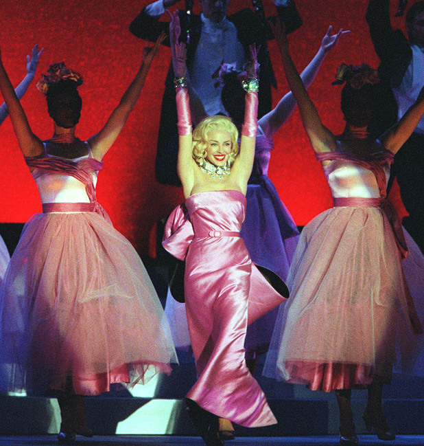 Kylie Minogue dones the iconic pink dress as she performs in Australia.