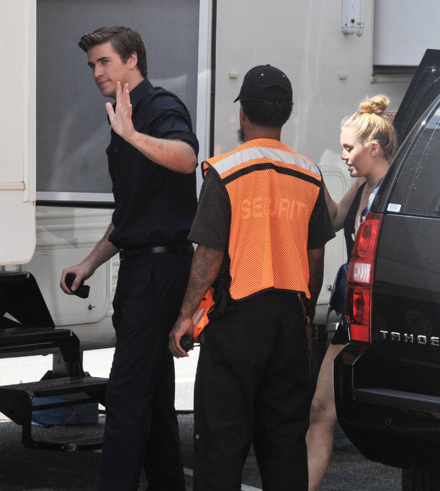 Miley Cyrus visits Liam Hemsworth on the set of his new film 'Paranoia' in Philadelphia Philadelphia, Pennsylvania