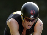 Lance Armstrong competes in the Ironman Panama 70.3. triathlon in Panama City, Sunday Feb. 12, 2012. The race consists of a 1.2-mile swim, a 56-mile bike ride and a 13.1-mile run.